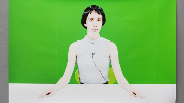 Lady in front of green screen