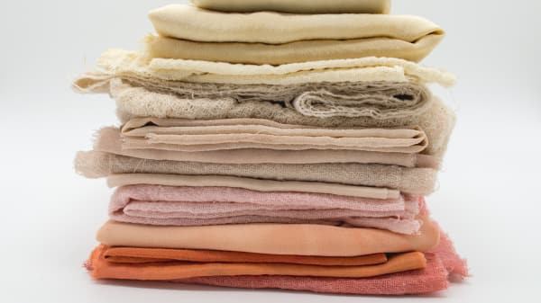 a pile of different fabrics