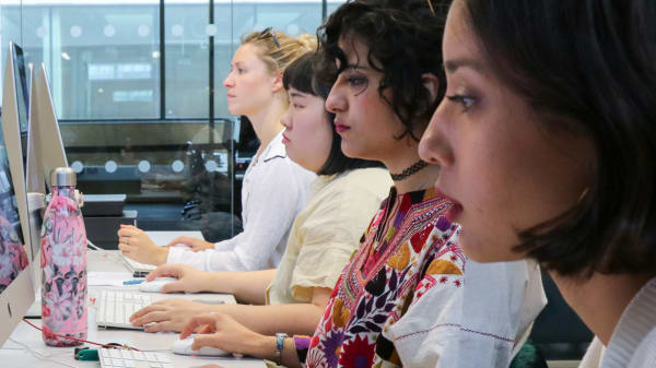 Students work at computers