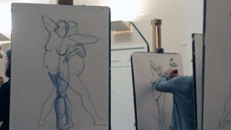 Someone sketching a body at a life drawing class