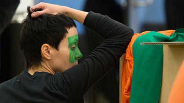 Woman with green face paint