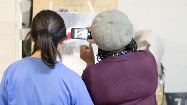 Photographing student work on an easel