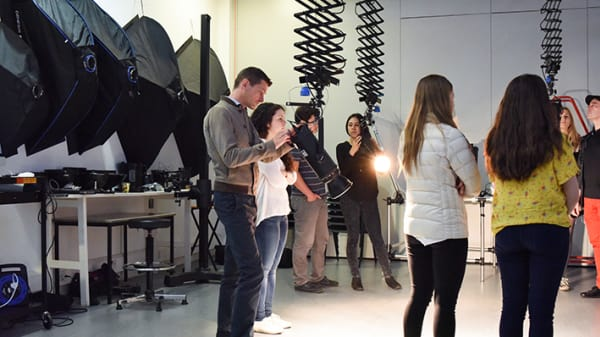 A group of people in a photography studio