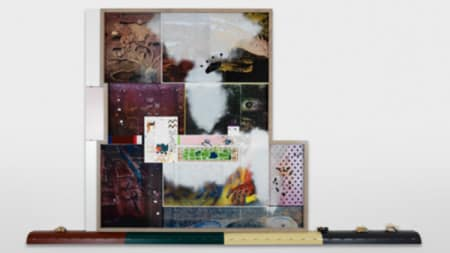 A collage of photographs and different imagery presented against a white wall