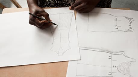 Close up of a person drawing on paper