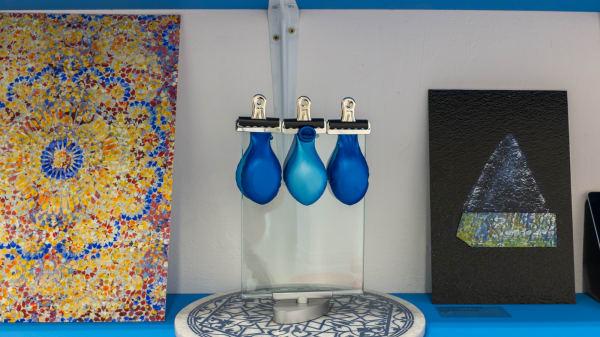 empty blue balloons on a shelf