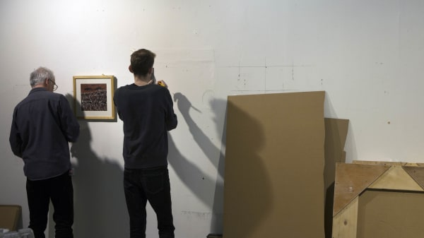 Students learning to install an exhibition
