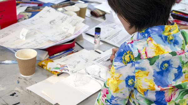 Student working on a book Illustration