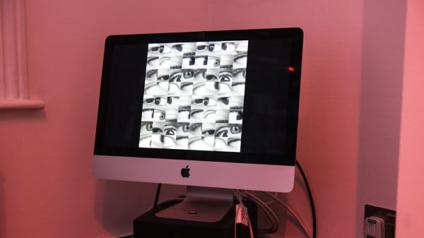 Pink background with computer screen showing black and white images of eyes - image for Short Courses at LCC Starting Soon