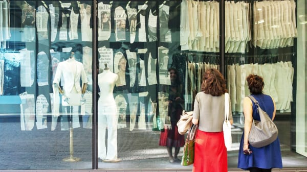 Two women looking at window display