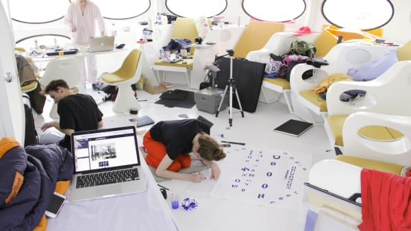 Students working inside Futuro House