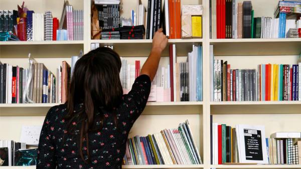 Student in art bookshop