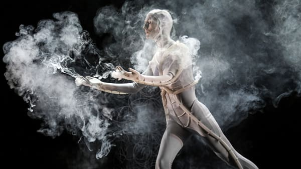 Photo of a man in a costume surrounded by smoke