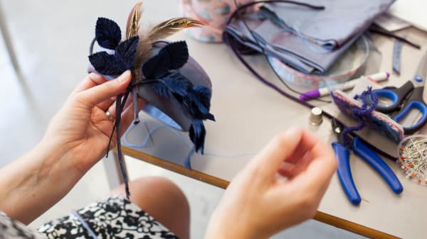 Millinery 2- Student working on a fascinator hat