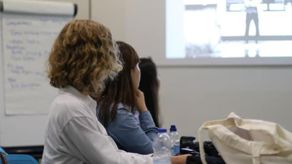 Students look at screen