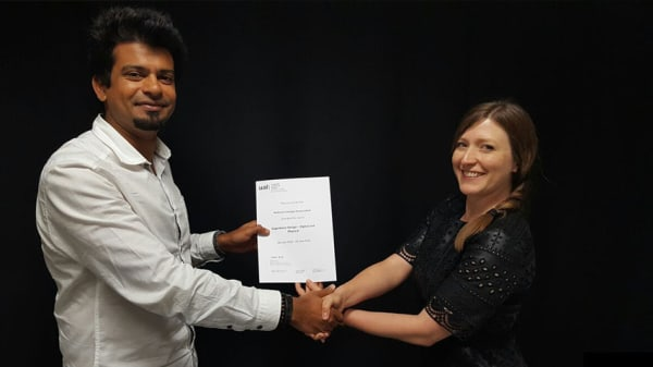Photo of UAL certificate being presented