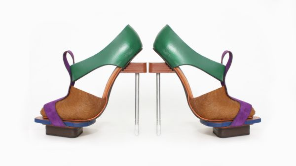 A pair of green, blue and brown shoes produced by a student at London College of Fashion