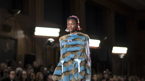 A female model wearing fur and stripes