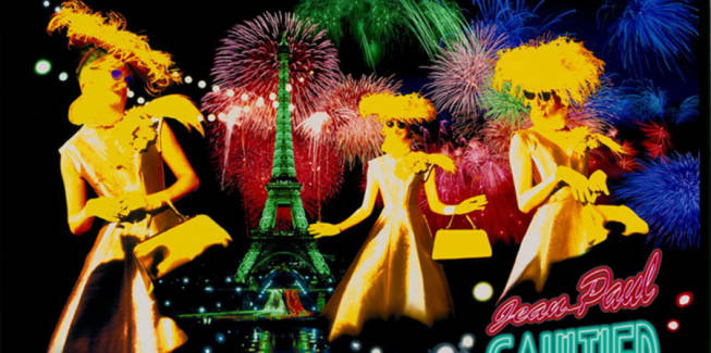 3 models in foreground; Eiffel Tower and fireworks in background
