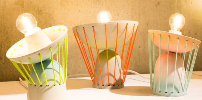 A series of flexible desk lamps designed with brightly coloured elements