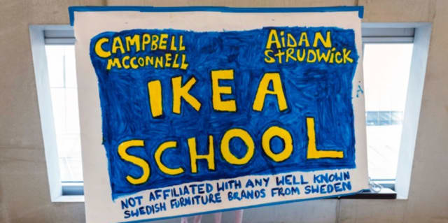 Handmade sign with 'Ikea school' written on it