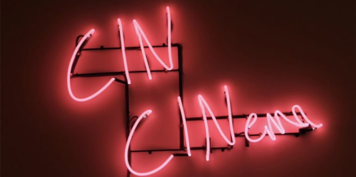 'Cin Cinema' written in pink neon