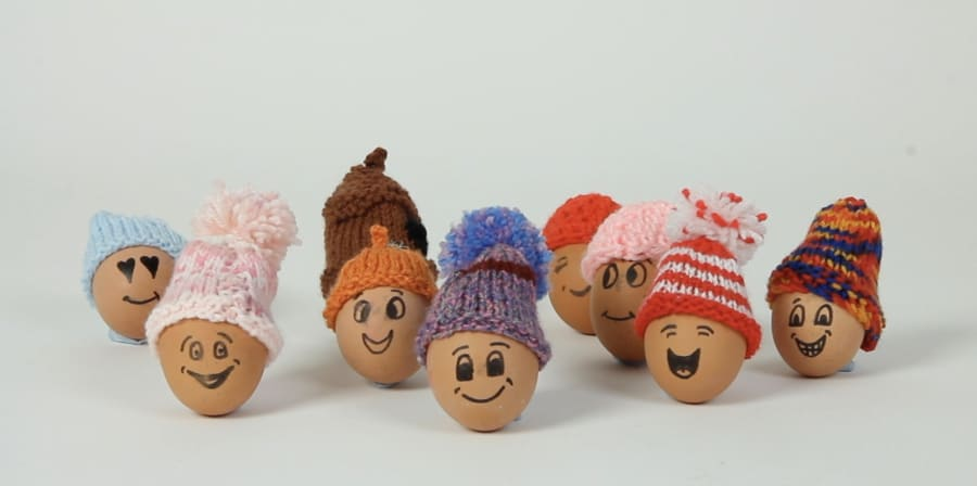 A still of eggs with smiles and bobble hats.