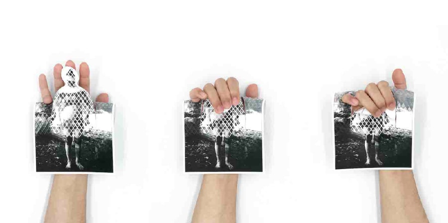 three hands hold postcards cut out