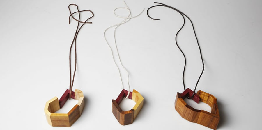 A collection of wooden jewellery pieces