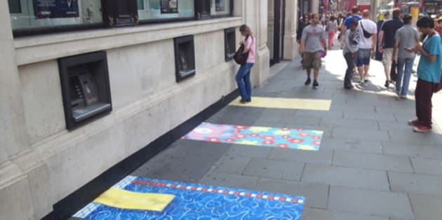 Colourful patterned paving stones around cash machines