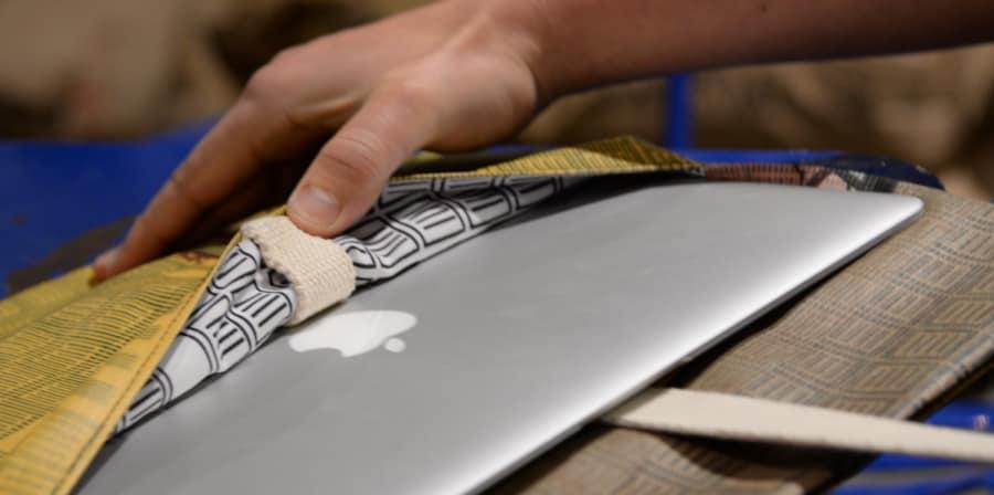 MAC laptop being put in a case