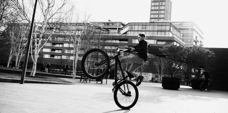 Kid doing bike tricks