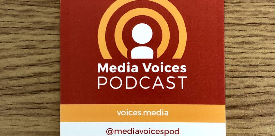 A business card featuring the microphone logo of the Media Voices Podcast.