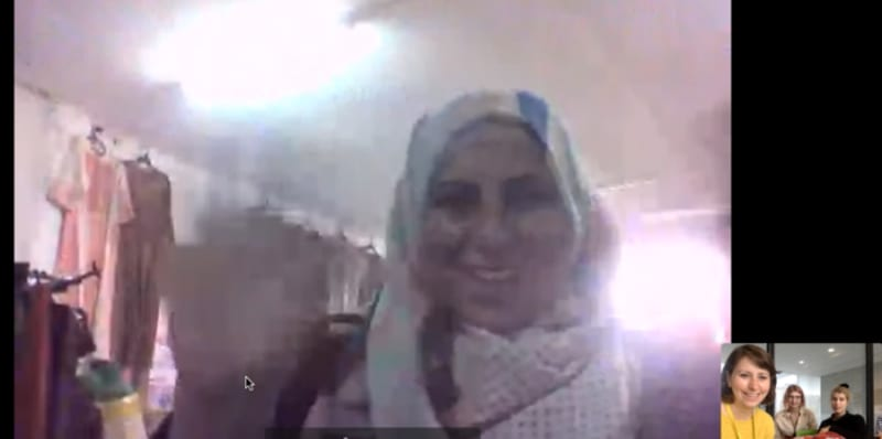 Screenshot of a woman on a Skype call
