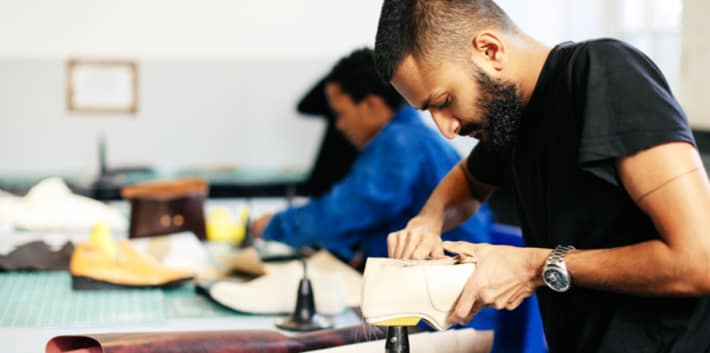 Male student working on a footwear project