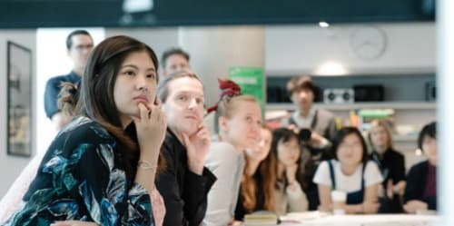 Students listening at