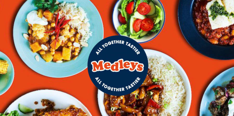 A red tablecloth covered in healthy fast-food, branded with a blue circle logo which reads 'Medleys'.