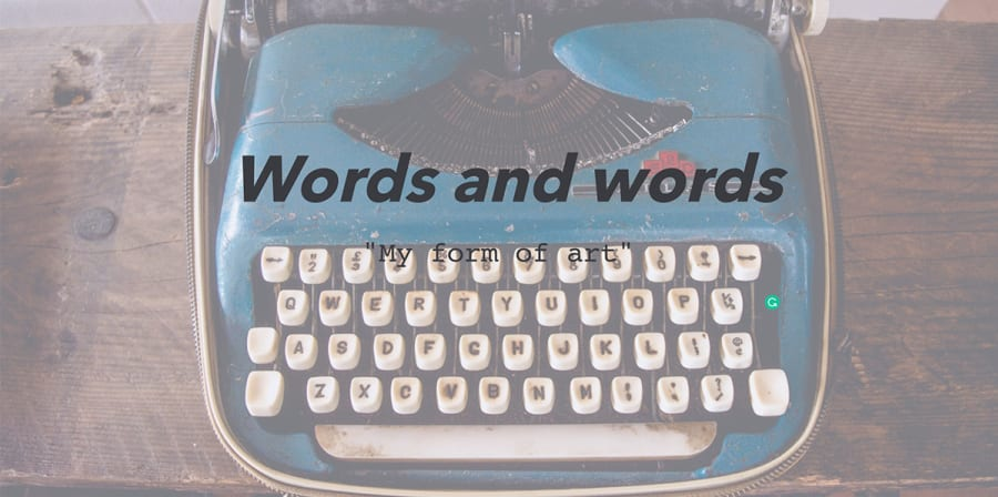 The text 'words and words' is printed over a photograph of a blue typewriter.
