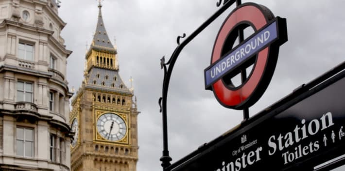 London Underground tube sign and Big Ben in background
