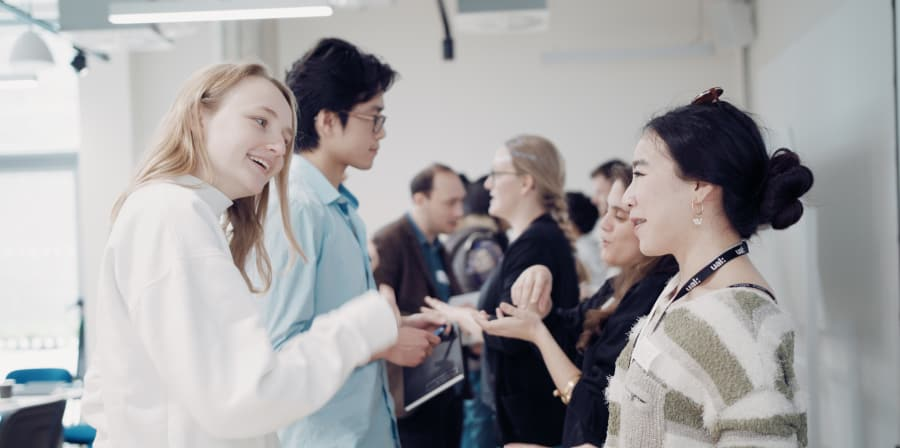 Two graduates or students networking