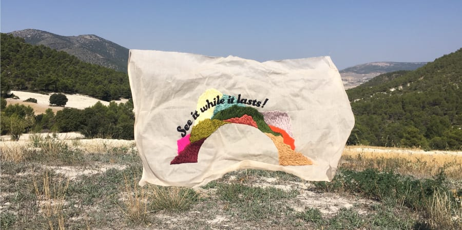 Embroidered flag in the winderness by Bronwyn Seier - Almeria, Spain