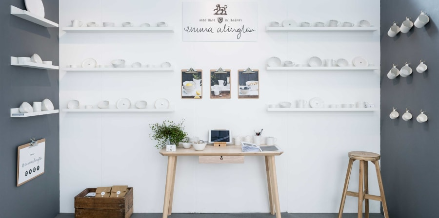 Exhibition space with white ceramic cups on display.