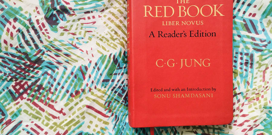 Image depicts The Red Book on a floral background.
