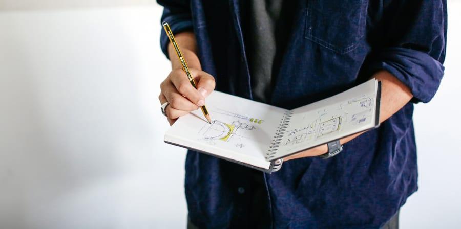 Student holding a sketchbook