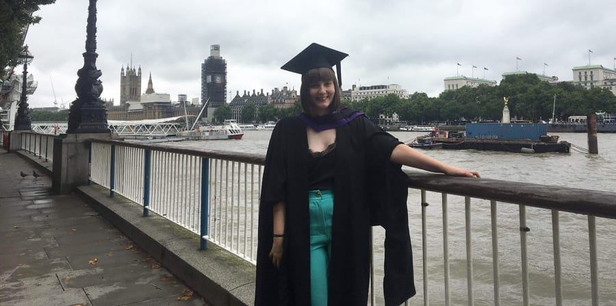 Hannah stands on the South Bank after graduating from LCC.