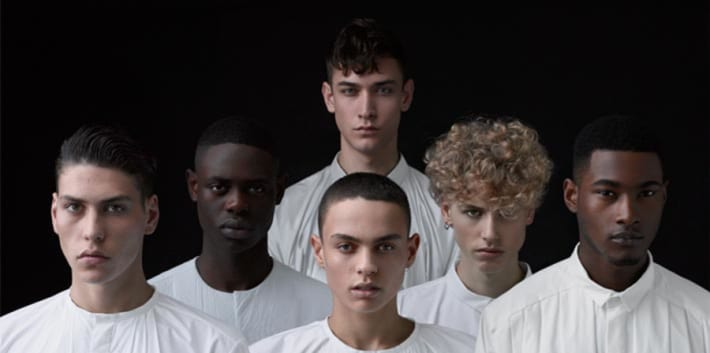 Group of young male models looking at the camera