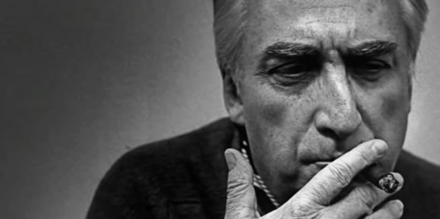 A black and white portrait of Roland Barthes