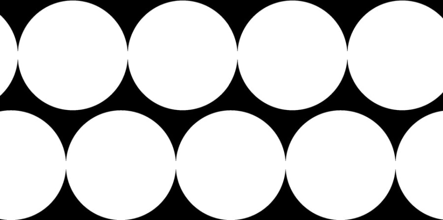 Two rows of white circles on a black background