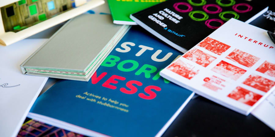 Examples of student Graphic Design work in the form of colourful booklets.