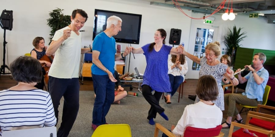 People dancing in a care home